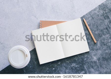 Top view white binder blank notebook or diary or journal for writing text and message with pencil and coffee cup on concrete background with copy space. Business and education concept. Royalty-Free Stock Photo #1618781347