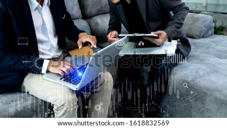 Concept of digital diagram, graph interfaces, Connections icon,Teamwork at business meeting, Business people working with laptop and tablet talking together in the modern Office. #1618832569