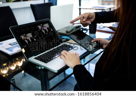 Concept of digital diagram, graph interfaces, Connections icon,Teamwork at business meeting, Business people working with laptop and tablet talking together in the modern Office. #1618856404