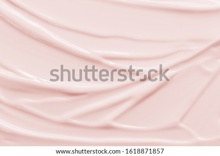 Beauty cream texture background. Pink color face cream lotion moisturizer smear. Skincare cosmetic  product  strokes #1618871857