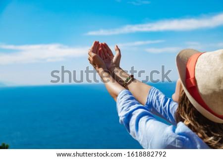Woman enjoying nice tropical summertime days. #1618882792