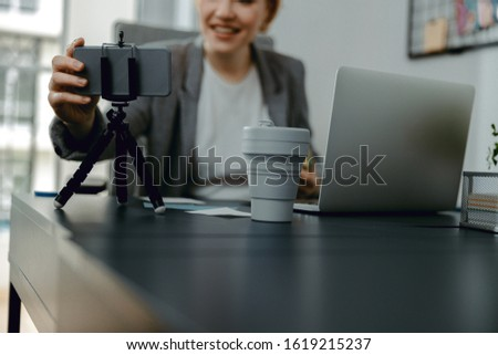 Cropped photo of looking at smartphone camera while making video stock photo