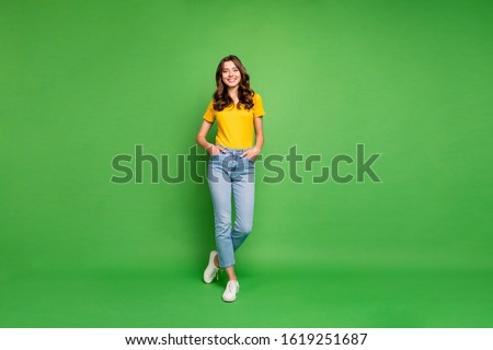 Full length body size view of her she nice attractive lovely cheerful cheery content wavy-haired girl holding hands in pockets isolated over bright vivid shine vibrant green color background Royalty-Free Stock Photo #1619251687