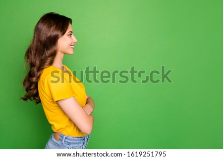 Profile side view portrait of nice attractive charming pretty cute winsome cheerful cheery content teen wavy-haired girl folded arms isolated on bright vivid shine vibrant green color background #1619251795