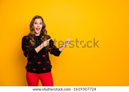 Photo of funky satisfied lady open mouth indicate fingers empty space advising low shopping prices wear hearts pattern pullover red pants isolated yellow color background #1619307724