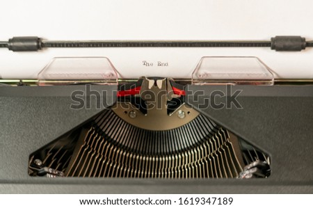 An almost obsolete tool for writing the typewriter here with The End typed out #1619347189