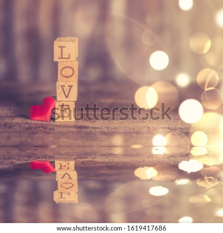 Valentine's Day picture and a love message written in wooden blocks. jpeg format