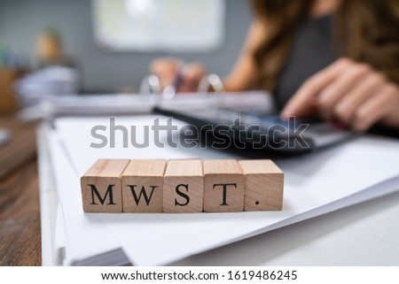 Businessperson Calculating MwSt. - Value-added tax in Germany #1619486245