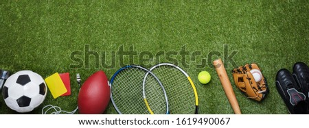 High Angle View Of Various Sport Equipment On Green Grass #1619490067