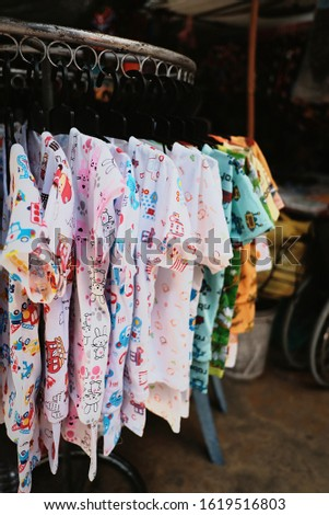 Baby clothes at the clothes drying rails #1619516803