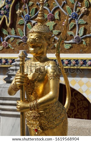 Golden Figure Fragment And Detail Of The Architecture Of Historical Buddhist Temples. Typical Traditional Sculpture Of The Grand Palace In Bangkok Metropolis, Thailand. #1619568904