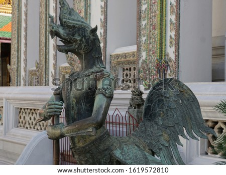 Detail of the architecture, figure fragment of Buddhist temples. Typical traditional sculpture of The Grand Palace in Bangkok Metropolis, Thailand. #1619572810