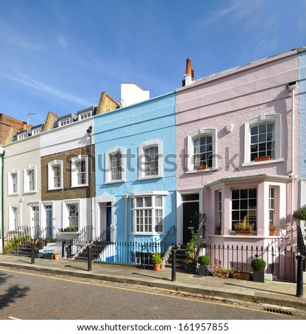 London street of colourful old terraced houses without parked cars #161957855