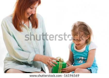 Mum gives the daughter a gift #16196569