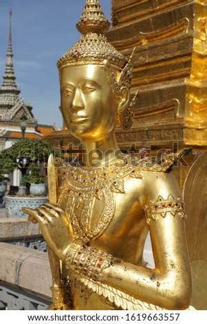 Detail of the golden architecture, figure fragment of Buddhist temples. Typical traditional sculpture of The Grand Palace in Bangkok Metropolis, Thailand. #1619663557