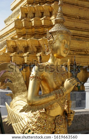 Detail of the golden architecture, figure fragment of Buddhist temples. Typical traditional sculpture of The Grand Palace in Bangkok Metropolis, Thailand. #1619663560