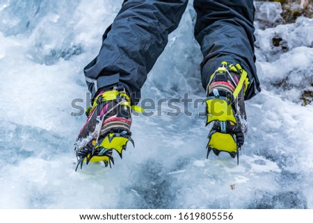 Closeup of Hiking Boots with Mounted Crampons used for Ice Climbing #1619805556