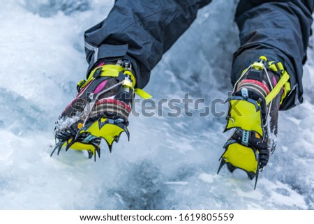 Closeup of Hiking Boots with Mounted Crampons used for Ice Climbing #1619805559