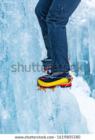 Closeup of Hiking Boots with Mounted Crampons used for Ice Climbing #1619805580