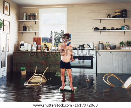 kids play on the table while flooding in the kitchen. Photo and media photocombination Royalty-Free Stock Photo #1619972863
