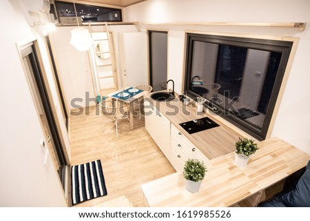 Mobile tiny house interior. Great for outdoor experiences and wildlife. Lots of space and pure adventure.  Royalty-Free Stock Photo #1619985526