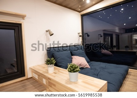 Mobile tiny house interior. Great for outdoor experiences and wildlife. Lots of space and pure adventure.  Royalty-Free Stock Photo #1619985538