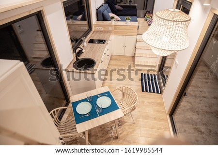 Mobile tiny house interior. Great for outdoor experiences and wildlife. Lots of space and pure adventure.  Royalty-Free Stock Photo #1619985544