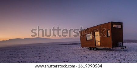Mobile tiny house. Great for outdoor experiences and wildlife. Lots of mobility and pure adventure. Royalty-Free Stock Photo #1619990584