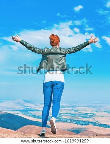 Beauty woman outdoors enjoying nature. Teenage girl enjoy with sunshine in field. #1619991259