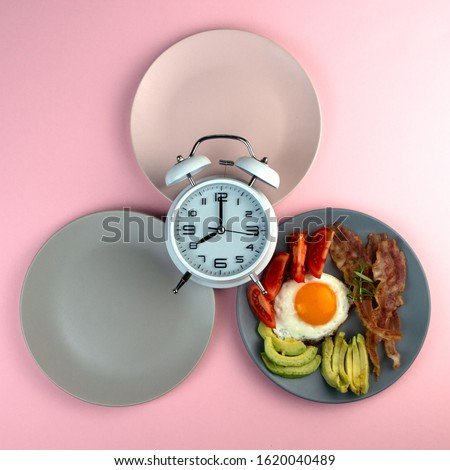 Intermittent fasting concept with empty colorful plates. Time to lose weight , eating control or time to diet concept. Royalty-Free Stock Photo #1620040489
