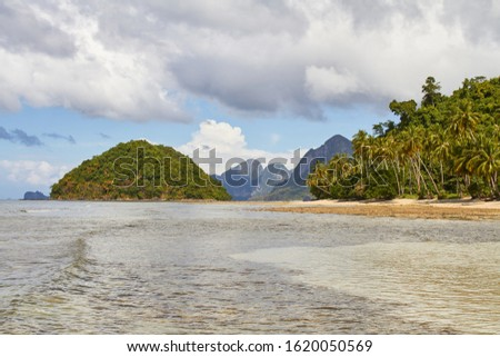 Beautiful scenic marine tropical landscape. Sea and waves, rocky cliffs, mountains. In El Nido. Palawan. Philippines #1620050569