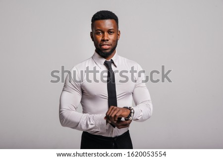 Happy confident young african american business male smiling with confidence, executive stylish company leader. Portrait of an businessman wearing suit and tie isolated on white background #1620053554