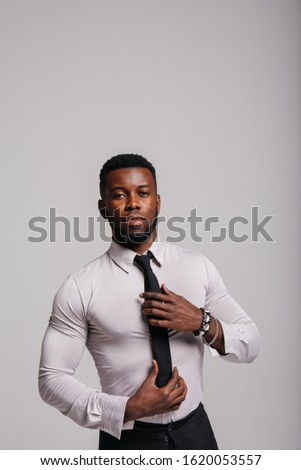 Happy confident young african american business male smiling with confidence, executive stylish company leader. Portrait of an businessman wearing suit and tie isolated on white background #1620053557