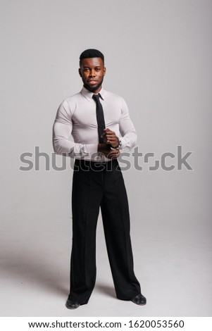 Happy confident young african american business male smiling with confidence, executive stylish company leader. Portrait of an businessman wearing suit and tie isolated on white background #1620053560