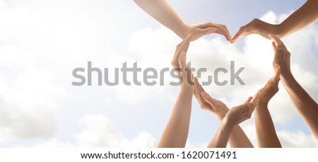 Symbol and shape of heart created from hands.The concept of unity, cooperation, partnership, teamwork and charity. #1620071491