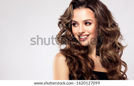 Beautiful laughing brunette model  girl  with long curly  hair . Smiling  woman hairstyle wavy curls .  Fashion , beauty and make up portrait  #1620127099