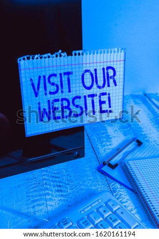 Conceptual hand writing showing Visit Our Website. Business photo text visitor who arrives at web site and proceeds to browse Note paper taped to black screen near keyboard stationary. #1620161194