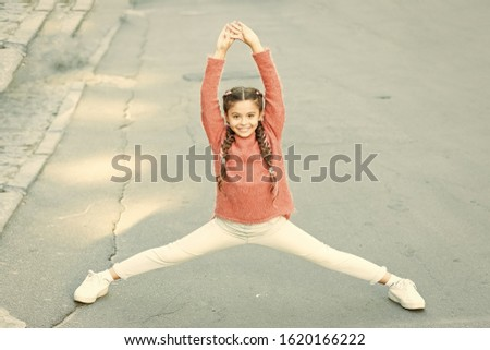 Athletic is beautiful. Athletic child do splits. Small girl perform lower body athletic training. Leg stretching workout. Warmup exercises. Sport and fitness. Athletic and flexible. #1620166222