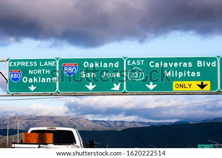 Highway 880 and Highway 237 interchange in South San Francisco Bay Area; Freeway signage providing information about the lanes going to Oakland and San Jose, California #1620222514