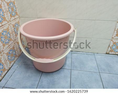 Clean bucket on clean toilet #1620225739
