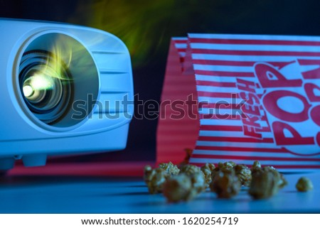 Watching a movie in a movie theater. Leisure, popcorn and movies #1620254719