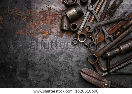Flat lay Old hand tools ,Pliers screwdriver wrench rusted iron metal tools on Steel plate at garage   #1620310600