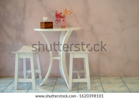 Two white wooden chairs with table and flower in vase modern interior with modern wall background #1620398101