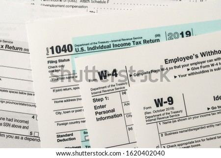 Paper blanks of 1040, w4 and w9 tax form close up #1620402040