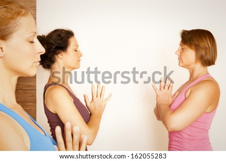 An image of some people doing yoga exercises #162055283