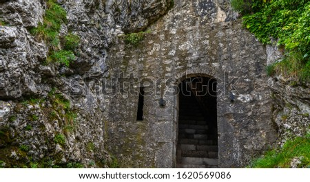 Exterior of the entrance to the citadel of Sisteron, rock fortress in the south of France, Europe. Listed as UNESCO World Heritage Site. Stone wall with traces of weathering and destruction. #1620569086