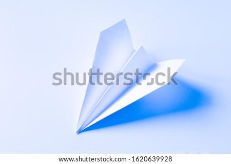 image of a white paper airplane minimalist scene