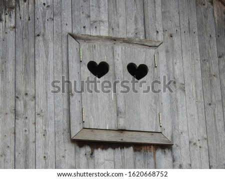 Old wooden rustical window with hearts. #1620668752