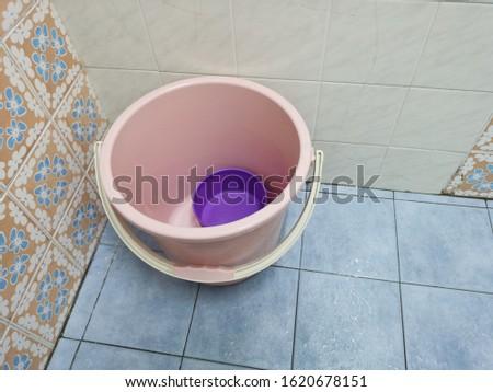 Clean bucket on clean toilet #1620678151
