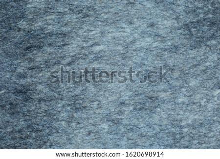 grey felt background. the texture of the felt. woolen fabric. #1620698914